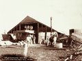 Queensland State Archives 2262 Threshing plant shed stack and workmen Hodgson Roma 1899.png