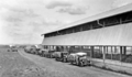 Queensland State Archives 4155 Bags of wheat being delivered by motor vehicles at the grain shed Bongeen November 1934.png