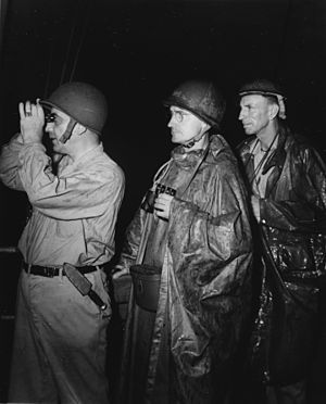 Ronald Hopkins - Hopkins (right, at back), with Rear Admiral Daniel E. Barbey and Brigadier General Clarence A. Martin, at Saidor, January 1944