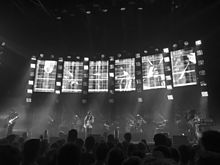Radiohead performing on stage behind a bank of monitors