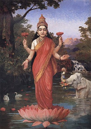 Hindu iconography - Goddess Lakshmi holding and standing on a lotus.