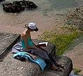 Reading a book at the beach (69838560).jpg