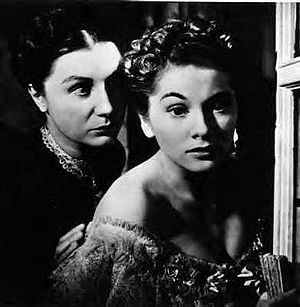 Thriller film - A common theme in thrillers involves innocent victims dealing with deranged adversaries, as seen in Hitchcock's film Rebecca (1940), where Mrs. Danvers tries to persuade Mrs. De Winter to leap to her death.