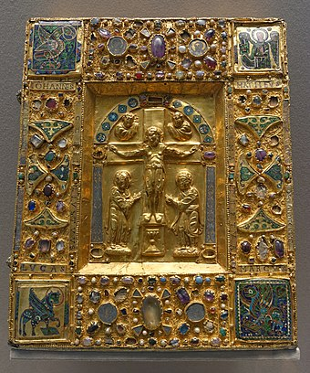 An 11th-century reliquary of gold and cloisonne over wood, from the Duchy of Brabant, Maastricht Cathedral, now housed in the Louvre. Reliquary-box crucifixion Louvre MR349.jpg
