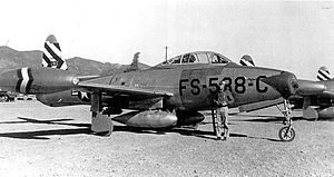 """7th Fighter Squadron - Republic F-84G Thunderjet 51-10538 """"Damn Yankee"""", 7th Fighter-Bomber Squadron, shown at Pohangdong AB (K-3), South Korea, equipped with wing pylon fuel tanks and JATO Bottles"""