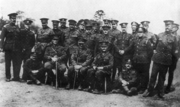 Soldiers in British uniforms of First World War vintage pose for a formative shot