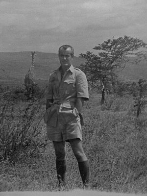 Robert Conley (reporter) - Conley in Kenya with a giraffe in the background
