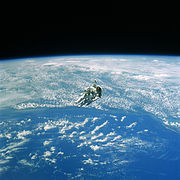 Robert L. Stewart, hanging above the Earth - DF-SC-84-10569