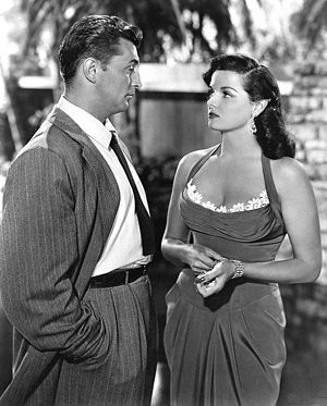 His Kind of Woman - Robert Mitchum with Jane Russell in a scene from the film