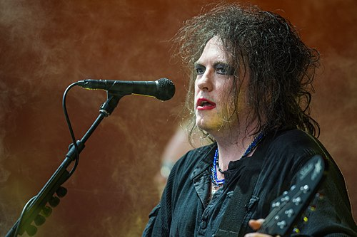 Robert Smith performing at the Roskilde Festival in 2012. Robert Smith - The Cure - Roskilde Festival 2012 - Orange Stage.jpg