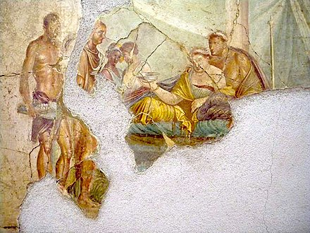 Roman painting from the House of Giuseppe II, Pompeii, early 1st century AD, most likely depicting Cleopatra VII, wearing her royal diadem, consuming poison in an act of suicide, while her son Caesarion, also wearing a royal diadem, stands behind her Roman Wall painting from the House of Giuseppe II, Pompeii, 1st century AD, death of Sophonisba, but more likely Cleopatra VII of Egypt consuming poison.jpg