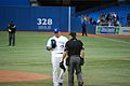 Romero discusses something with an umpire (7951997162).jpg