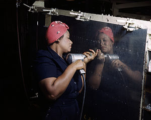 "United States home front during World War II - ""Rosie the Riveter"", working on an A-31 ""Vengeance"" dive bomber, Tennessee, 1943."