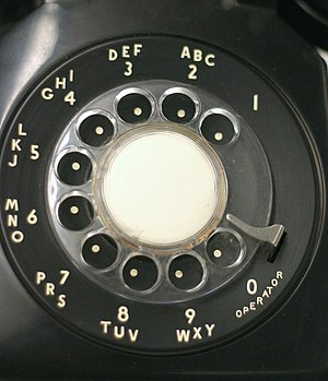 Rotary dial - A traditional North American rotary phone dial. The associative lettering was originally used for dialing named exchanges but was kept because it facilitated memorization of telephone numbers.