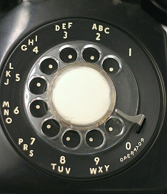 Rotary dial - A traditional North American rotary phone dial stands at 2 inches tall (5 cm) and 3.5 inches wide (7 cm). The associative lettering was originally used for dialing named exchanges but was kept because it facilitated memorization of telephone numbers.