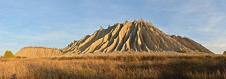 A spoil tip covered in rills and gullies due to erosion processes caused by rainfall: Rummu, Estonia Rummu aherainemagi2.jpg