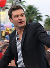 Ryan Seacrest, executive producer, wearing a black blazer in 2009