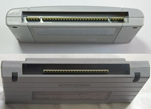 A photo showing the bottom ends of a PAL SNES / Japanese SFC cartridge and a North American SNES cartridge.