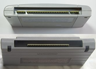 Regional lockout - Cases for SFC games in Japan (top) and North American (bottom) regions. Notice the slots in the bottom cartridge to accommodate for plastic tabs in the North American console.