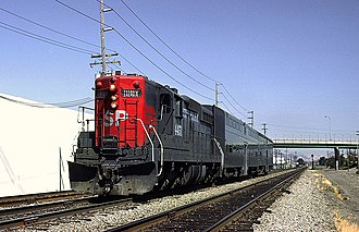 Peninsula Commute - West of Santa Clara, a Southern Pacific EMD SD9 leads a two-car train before the Caltrain takeover
