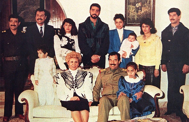Family Photograph of Saddam Hussein Family from mid-late 1980's. From Top Left Clockwise, Hussein Kamel, Saddam Kamel, Rana Hussein, Uday Hussein, Raghad Hussein, Sahar Maher Abd al-Rashid, Qusay Hussein, Hala Hussein, Saddam Hussein, Sajida Talfah, Unidentified Child.