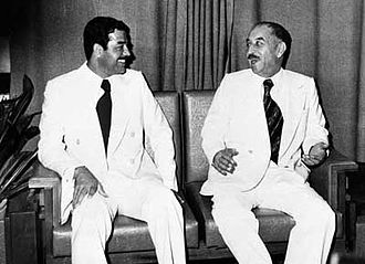 Ba'athist era presidents Hassan al-Bakr and Saddam Hussein in 1978. Saddam Hussein and Hassan al-Bakr 1978.jpg