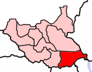 Owiny Ki-Bul is in East Equatoria (in red) bordering Uganda to the south, Kenya to the southeast and Ethiopia to the east.