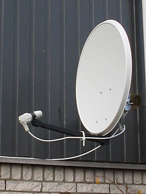 Offset dish antenna - Home satellite television dish.