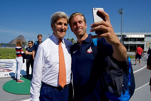 Secretary Kerry poses for a selfie with a member of the U.S. Men's Volleyball Team at the Brazilian Naval Academy in Rio de Janeiro (28787758755).jpg