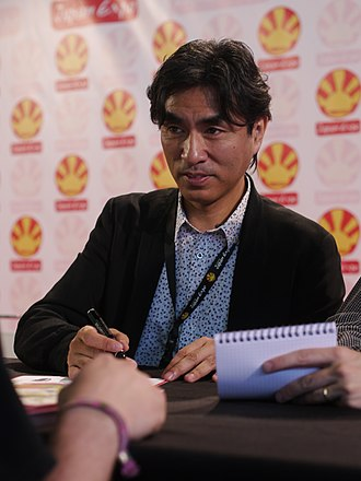 Shōji Kawamori - Taken during the 14th edition of Japan Expo in 2013 organised at the 'Parc de expositions of Villepinte near Paris in France.