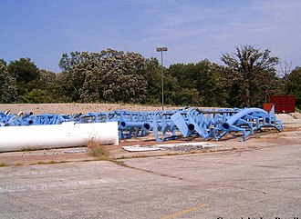 Shockwave (Six Flags Great America) - Pieces of Shockwave sitting in the employee parking lot in 2004.
