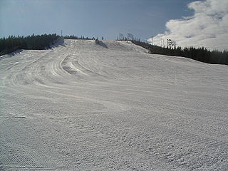 Piste path down a mountain for snow skiing, snowboarding, or other mountain sports