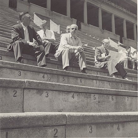 the stands of Churchill Downs in 1951; Gulf Oil executive and noted horse-racing enthusiast Willard F. Jones is seated second to left, in back row Stands of Churchill Downs 1951.jpg