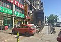 Station lift and restaurants near Gongyixiqiao Station (20160516143054).jpg