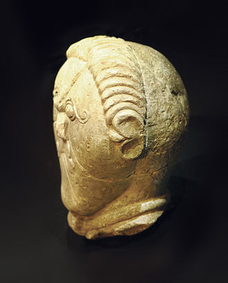Tonsure - Celtic stone head from ancient Bohemia (150-50 BC), possibly depicting the form of the later Celtic Christian tonsure.