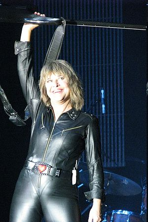 Annie Get Your Gun – 1986 London Cast - Quatro raising her bass guitar above her head during a rock performance at AIS Arena in Canberra, Australia on 26 September 2007