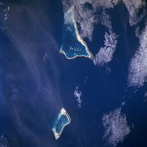 Maiana - Maiana Atoll can be seen on the bottom of this photograph, with the larger formation being Tarawa Atoll
