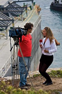 Telecinco crew at Gibraltar with the MV Fedra in the background.jpg