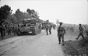 Glasgow Highlanders - Infantrymen of the 2nd Battalion, Glasgow Highlanders, 15th (Scottish) Division, with Churchill tanks of the 6th Guards Tank Brigade, near Moergestel, 26 October 1944.