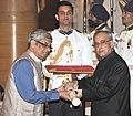 The President, Shri Pranab Mukherjee presenting the Padma Shri Award to Shri Bibek Debroy, at a Civil Investiture Ceremony, at Rashtrapati Bhavan, in New Delhi on April 08, 2015.jpg