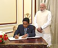 The President of the Republic of Maldives, Mr. Abdulla Yameen Abdul Gayoom signing the visitor's book, during the exchange of agreements and joint media briefing, in New Delhi.jpg