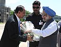 The Prime Minister, Dr. Manmohan Singh being received by the Governor of Andhra Pradesh, Shri E.S.L. Narasimhan, on his arrival at Tirupati Airport in Andhra Pradesh on September 01, 2010.jpg
