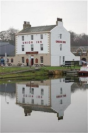 Camelon - The Union Inn, named for the Union Canal, reflected in the canal