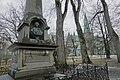 Thomas Angell (1692–1767) minnesmerke obelisk 1895 bust monument architect Karl Norum sculptor Carl Ludvig Jacobsen (orginal Hans Michelsen) Nidaros Cathedral Bispegata Trondheim Norway 2019-03-20 bare trees wet rainy grey etc 09680.jpg