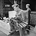Thompson submachine guns, or 'Tommy guns', being un-crated at an ordnance depot in the UK after their arrival from the US through the Lend-Lease scheme, 23 March 1942. H18068.jpg