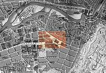 a picture of a map of 1913 Tiflis from above showing the layout of the city with a rectangular block in orange highlighting Yerevan Square and adjacent streets