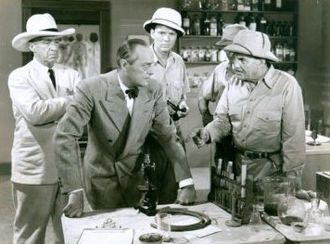 J. Farrell MacDonald - Movie still for Tiger Fangs (1943), J. Farrell MacDonald (left), Arno Frey (center), Frank Buck (right)