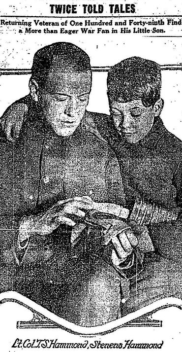 Hammond shows his son the gas mask he used in France, Chicago Daily Tribune, March 1919 Tom and Stevens Hammond.jpg