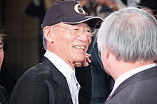"Tomino Yoshiyuki ""The World of Gundam"" at Opening Ceremony of the 28th Tokyo International Film Festival (22442055011).jpg"