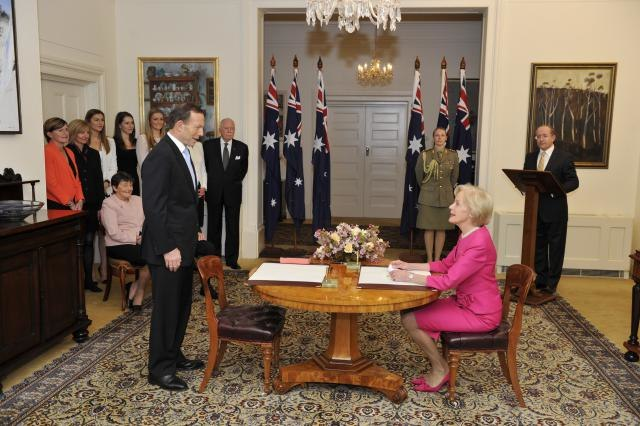 Tony Abbott being sworn in by Quentin Bryce (1)